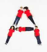 Image of Letter A made up of children